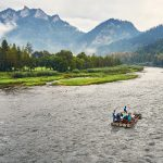 Beautiful panoramic view of the Dunajec river with rafting rafts and Pieniny National Park, Poland, in rainy and foggy september day. Pieniny National Park - Polish: Pieninski Park Narodowy - is a protected area located in the heart of Pieniny Mountains in the southernmost part of Poland. Administratively, the Park lies in the Lesser Poland Voivodeship on the border with Slovakia. Its head office is in Kroscienko nad Dunajcem. On the Slovak side of the mountains there is a parallel park called the Pieninsky n aodny park.